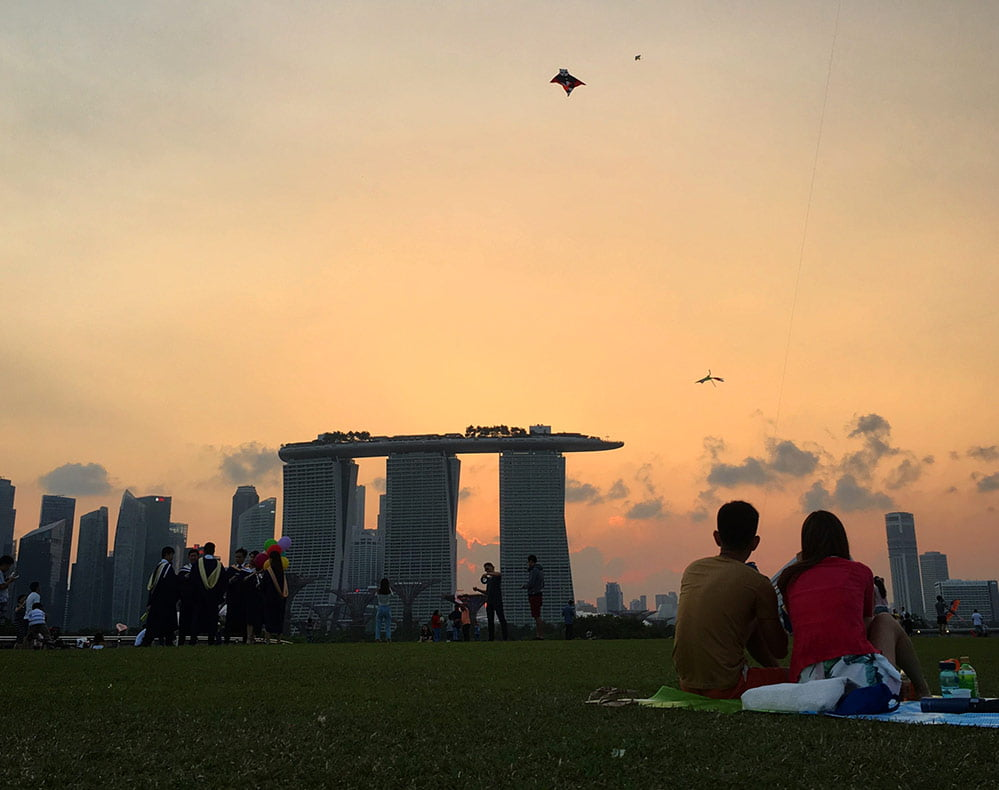 The glowing sunset view of Marina Bay Sands from Marina Barrage on a warm evening