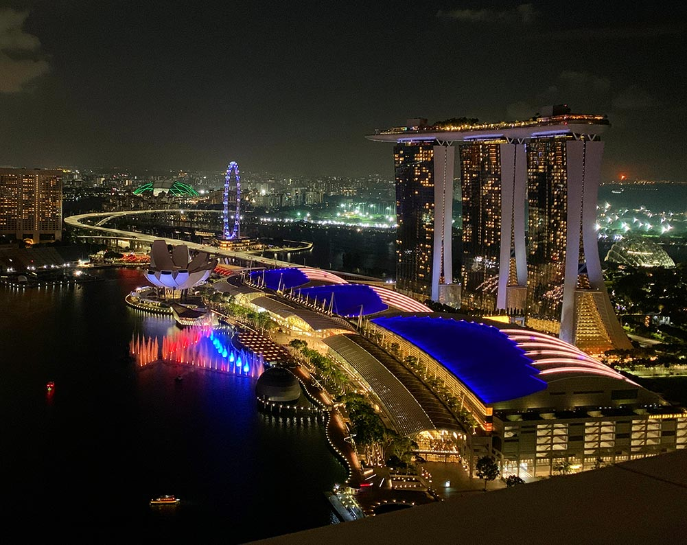 Singapore's majestic night view of Marina Bay Sands and the fountain show from 33 floors up