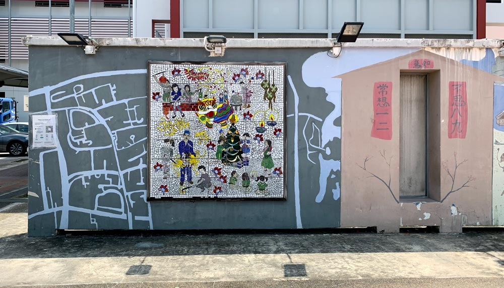 This wall has what looks like a rough map of the streets of Taman Jurong, a mosaic of multi-ethnic activities and something that looks like a Chinese shrine?