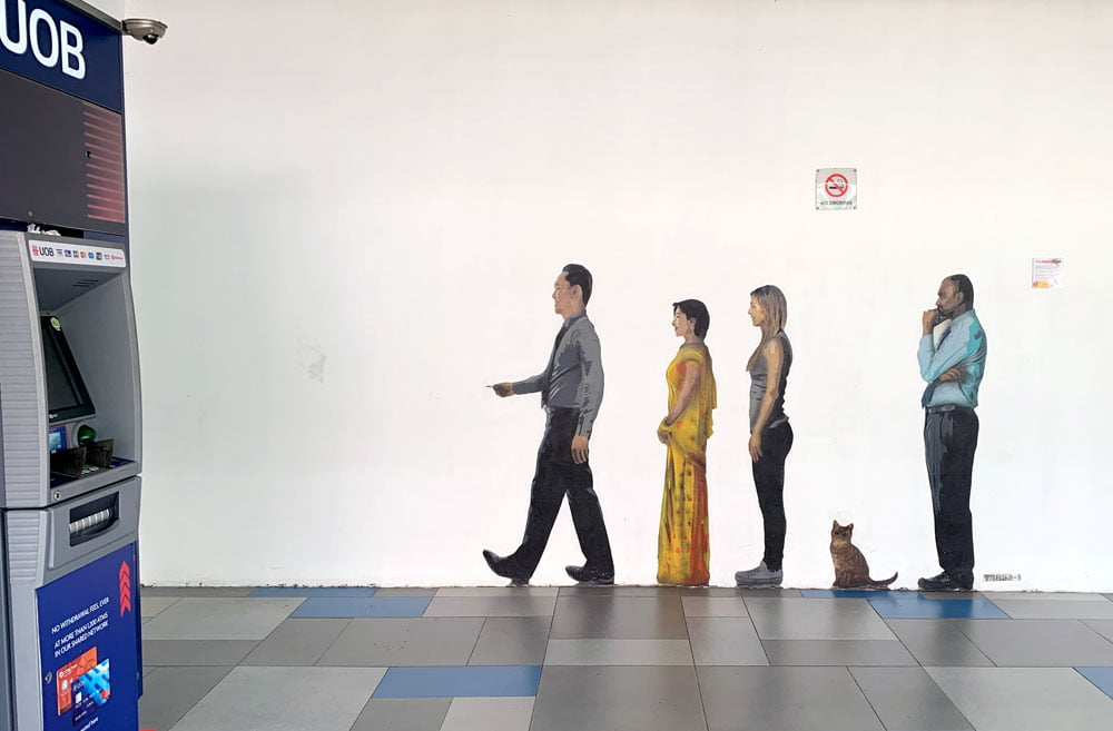 Trase's work sees 4 people and a cat lined up as if to use the ATM. The person right in front looks a lot like Lee Kuan Yew...