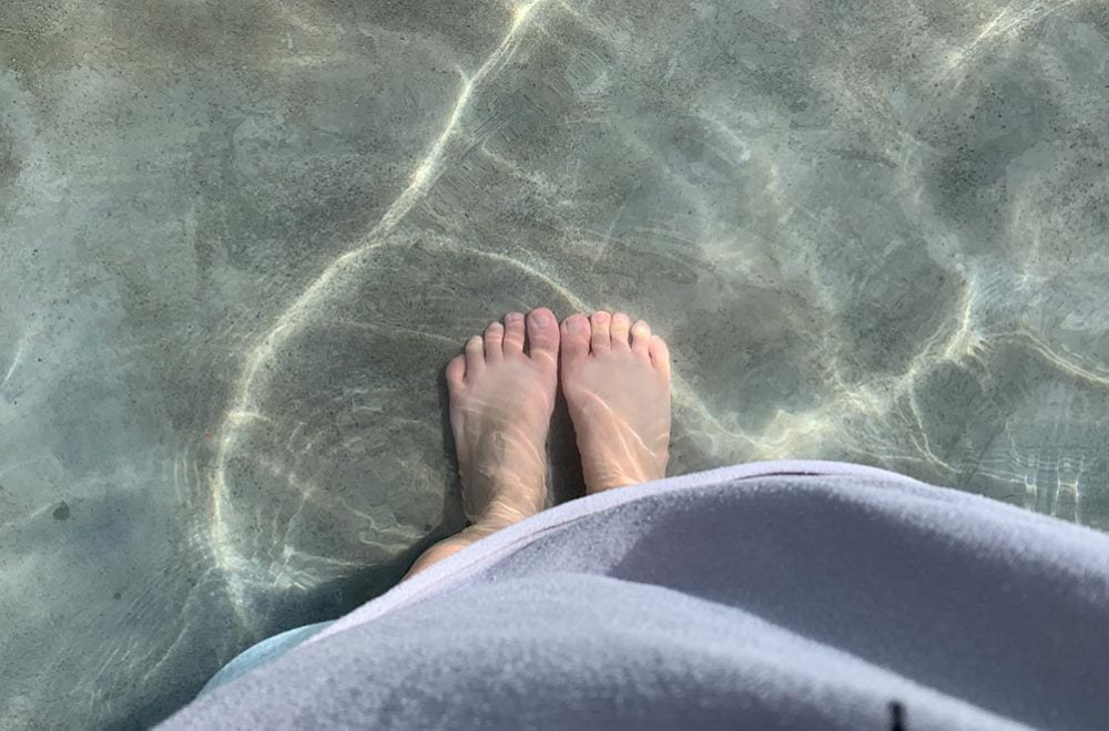 Looking down at my feet in the hot spring water. It got a bit too hot for me after awhile.